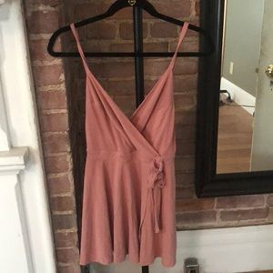 Super cute pink romper from Urban Outfitters